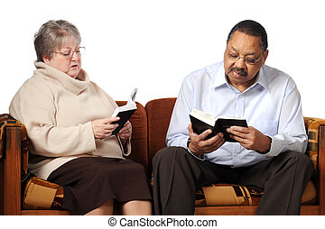 Senior Bible Study - A senior man and woman studying the...