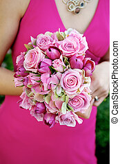 Bridesmaid Holding Bouquet - Image of a bridesmaid in a pink...