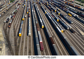 Aerial View of Many Train Cars on Tracks - Image of an...