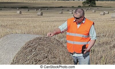 Farmer checking the hay bales