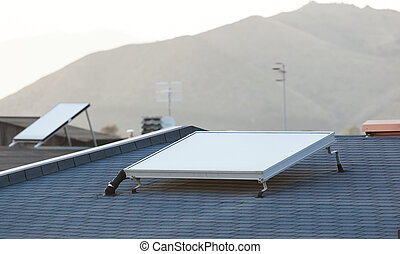 Solar panel for water heating system on the roof