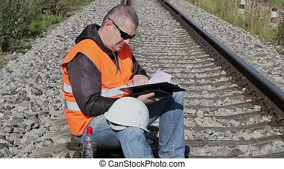 Railway Engineer with documentation on railway