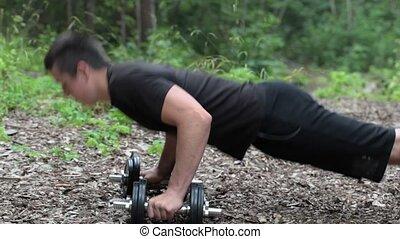 Teenager do push ups at outdoor