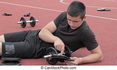 Teenager using tablet PC near
