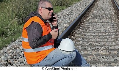 Railway Engineer with smartphone and bottle of water