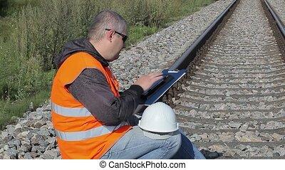 Railway Engineer with bottle