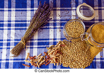 Lentils, couscous, pasta and lavender on the table