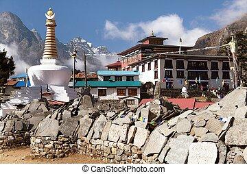 Tengboche monastery with stupa and prayer mani wall - View...