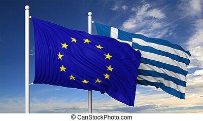 Waving flags of EU and Greece on flagpole, on blue sky...