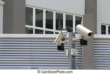 Security cameras - Two security cameras at the perimeter of...