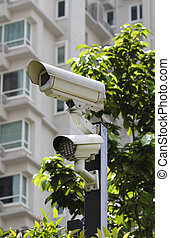 Security camera - A security camera with LED light at the...