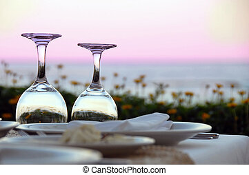 Table for dinner - outdoor table with wine glasses over...