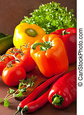 healthy vegetables pepper tomato salad onion on rustic background