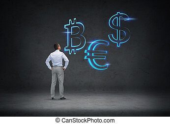 businessman looking at currency symbols - business, people,...