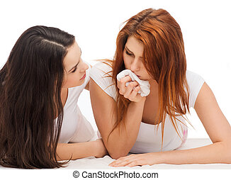 one teenage girl comforting another after break up -...