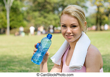 work out woman - a woman with towel around her neck and...