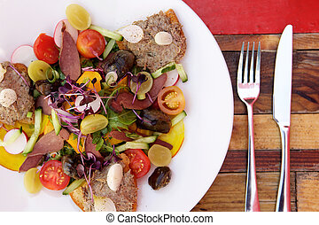 Fresh salad on a plate with toasted bread and meat pate