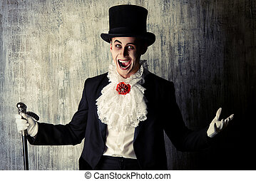 gentleman vampire - Handsome male vampire in a tail-coat and...