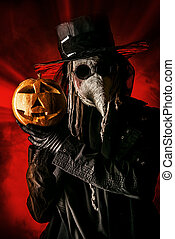 halloween simbol - Frightening plague doctor stands with a...