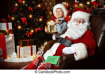 miracle - Santa Claus and laughing cute boy sitting in...