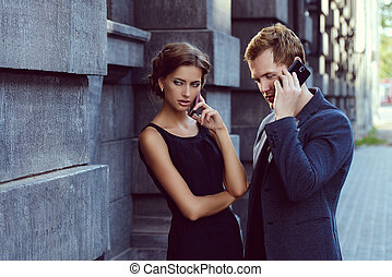 negotiations - Business people talking on the phone over...