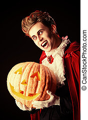 vampire and pumpkin - Portrait of a handsome vampire with...