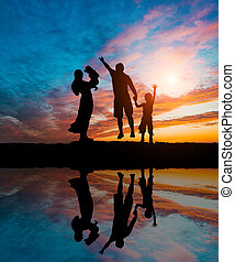 Silhouettes of happy family - Silhouettes of happy parents...