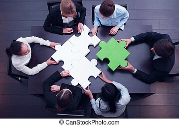 business team solving puzzle