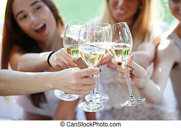 group of young women toasting