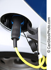 Electric car being charged at the station, close up of the...