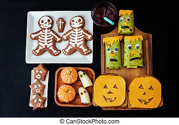 childrens with lunch in the form of monsters for Halloween....