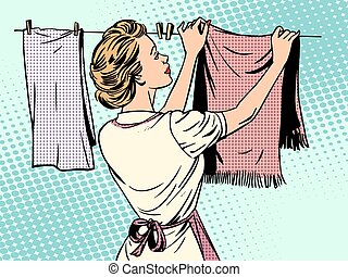 woman hangs clothes after washing housewife housework...