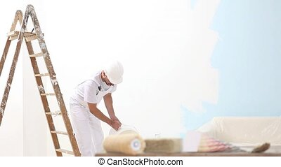 painter man at work, painting wall, painter house concept