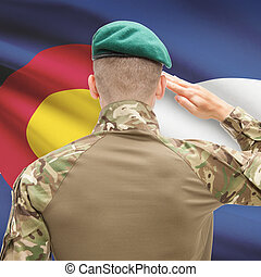 Soldier saluting to USA state flag conceptual series - Colorado