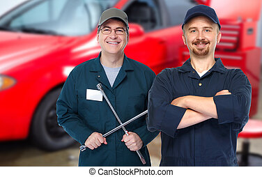 Car mechanic  with tire wrench.