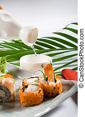 japanese sushi - delicious japanese sushi with saki being...