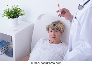Having an injection - Elder woman will have an injection in...