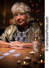 Old fortune teller has lots of trustful clients