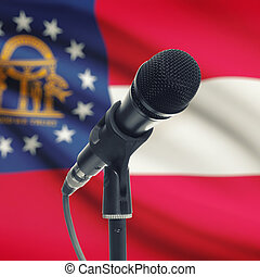 Microphone on stand with US state flag on background - Georgia