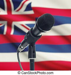 Microphone on stand with US state flag on background - Hawaii