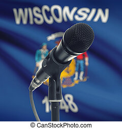Microphone on stand with US state flag on background - Wisconsin