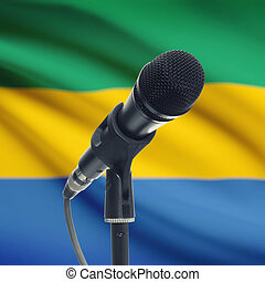 Microphone on stand with national flag on background - Gabon...