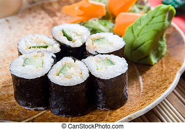 sushi rolls - delicious sushi rolls on table with garnish