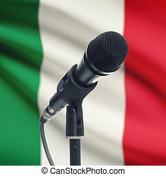 Microphone on stand with national flag on background - Italy...