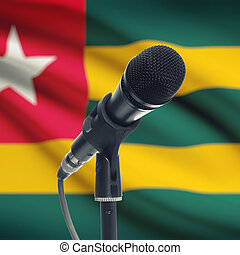 Microphone on stand with national flag on background - Togo...