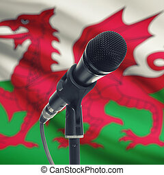Microphone on stand with national flag on background - Wales...