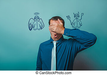 man Male businessman closed his eyes, his hands angel devil...