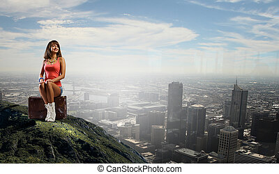 Hitch hiking traveling - Young retro woman sitting on her...