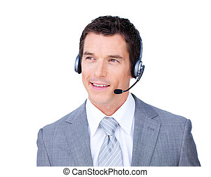 Smiling attractive businessman using headset