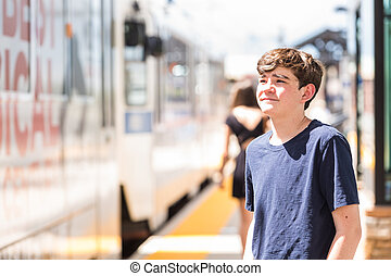 Teenager - Teenage boy at the lightrail station in urban...